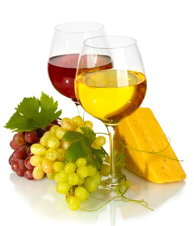 glasses of wine, cheese and ripe grapes isolated on white photo