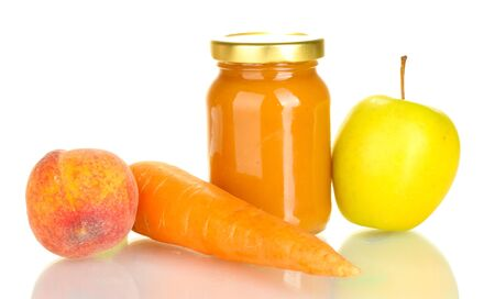 Jar with fruit and vegetable baby food isolated on white photo