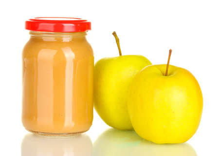 Jar with apple baby food isolated on white photo