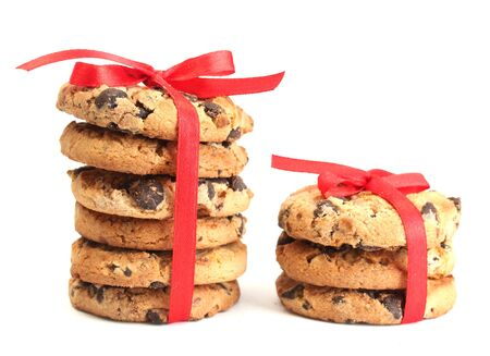 Chocolate chips cookies with red ribbons isolated on white Stock Photo - 14172641