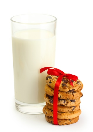 glass of milk and chocolate chips cookies with red ribbon isolated on white Stock Photo - 14162113