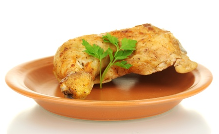 roasted chicken leg with parsley in the plate isolated on white photo