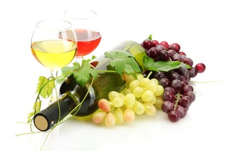 bottle and glasses of wine and ripe grapes isolated on white photo