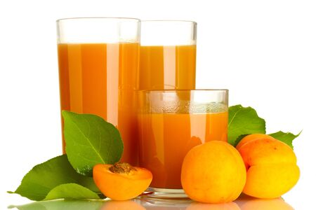 three glasses of apricot juice and apricots with leaf isolated on white photo