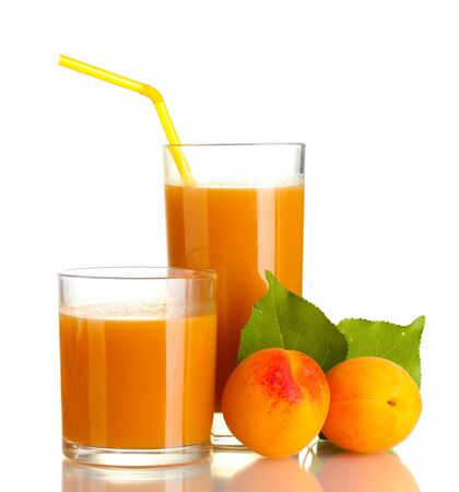 two glasses of apricot juice and apricots with leaf isolated on white photo