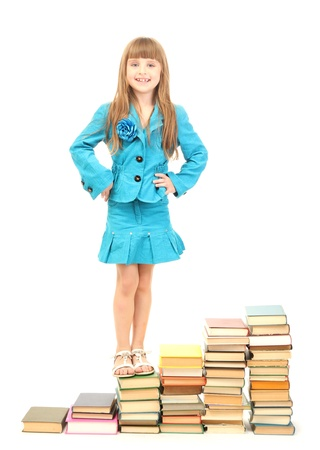 elementary age: little girl with a books isolated on white