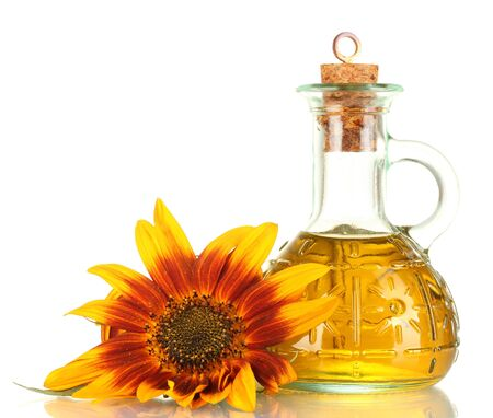 sunflower oil and sunflower isolated on white photo
