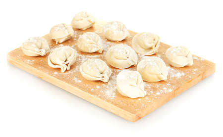 Raw Dumplings on cutting board isolated on white photo