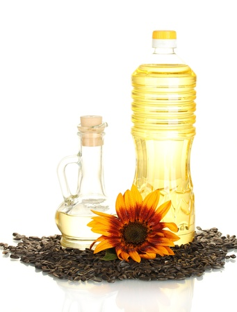 sunflower oil in a plastic bottle and small decanter isolated on white background photo
