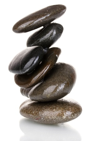 Stack of balanced stones isolated on white photo