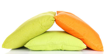 Bright color pillows isolated on white photo