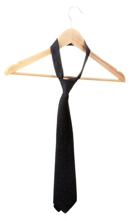 Elegant black tie on wooden hanger isolated on white photo