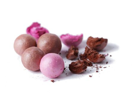 pink and brown powder balls isolated on white photo