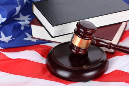 judge gavel and books on american flag background Stock Photo - 14178731