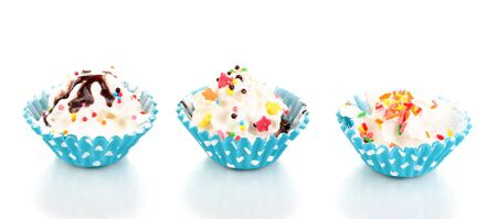 Creamy cupcakes isolated on white photo