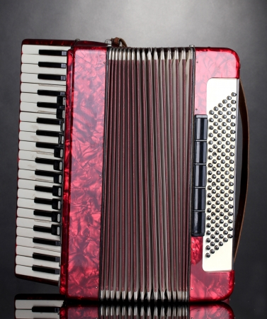 Retro accordion on grey background photo