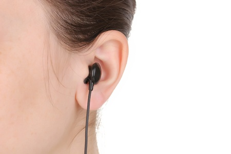 Human ear with earphone close-up isolated on white photo