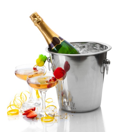 Champagne bottle in bucket with ice and glasses of champagne, isolated on white Stock Photo