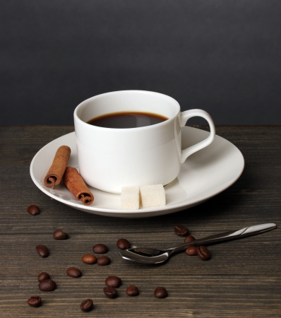 Coffee cup on wooden table on grey background photo