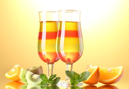 fruit jelly in glasses and fruits on yellow background Stock Photo - 14170114