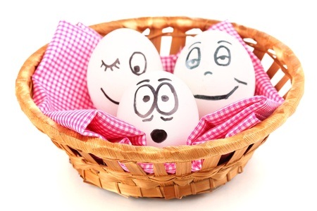 dodger: White eggs with funny faces in basket isolated on white Stock Photo
