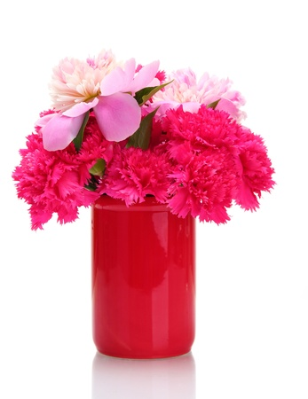 Bouquet of carnations and peonies in a vase isolated on white photo