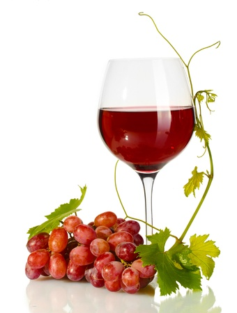 glass of wine and ripe grapes isolated on white photo