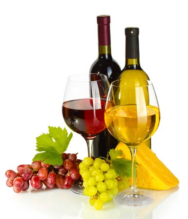 bottles and glasses of wine, cheese and ripe grapes isolated on white photo
