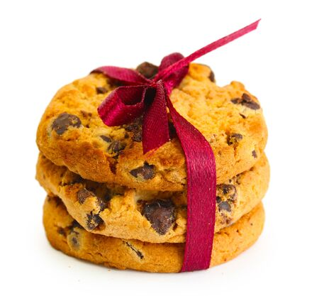 Chocolate chips cookies with red ribbon isolated on white Stock Photo - 14181928