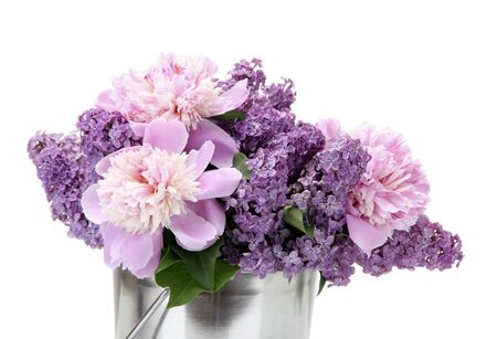 beautiful lilac and peonies flowers in metal bucket isolated on white photo