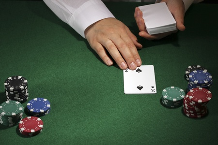 Poker setting on green table photo
