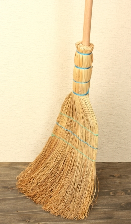 Broom on floor in room photo