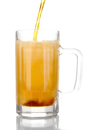 glass of kvass on white background