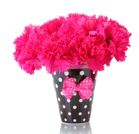 Bouquet of carnations in a cup isolated on white photo