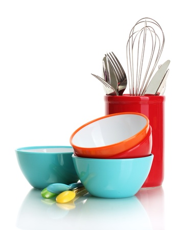 kitchen ware: bright empty bowls, cups and kitchen utensils isolated on white