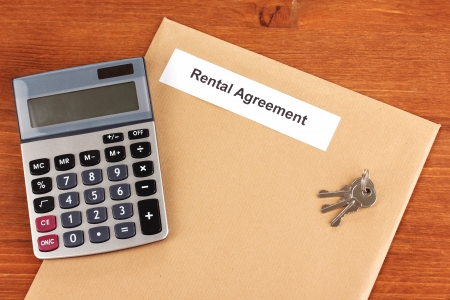 Rental agreement on wooden background close-up photo