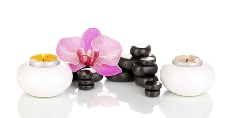 Spa stones with orchid flower and candles isolated on white photo