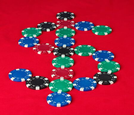 poker chips in the form of dollars on a red table photo