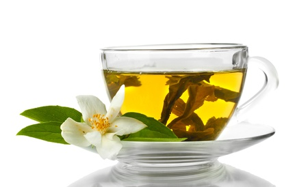 cup of green tea with jasmine flowers isolated on white photo