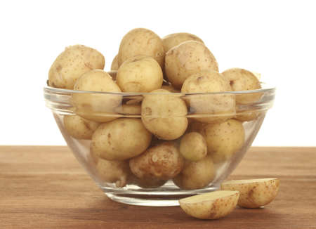 young potatoes in a glass bowl on a table on white background Stock Photo - 14292430