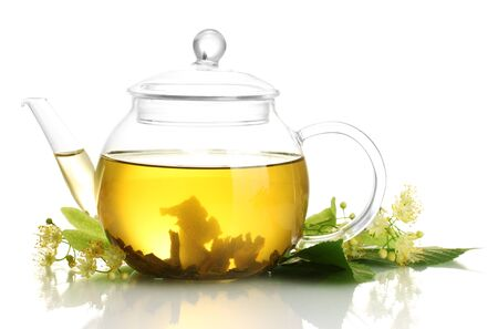 linden tea: teapot of linden tea and flowers isolated on white Stock Photo