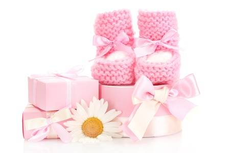 congratulation: pink baby boots, gifts and flower isolated on white