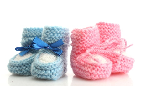 pink and blue baby boots isolated on white photo