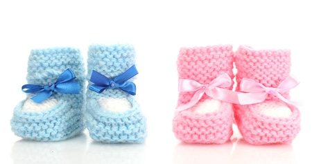 baby boy birth: pink and blue baby boots isolated on white