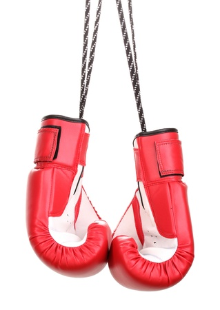 thai boxing: Red boxing gloves hanging isolated on white Stock Photo