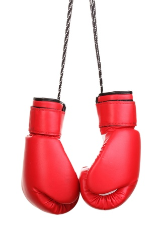 white gloves: Red boxing gloves hanging isolated on white Stock Photo