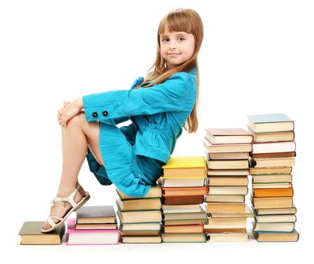little girl with a books isolated on white photo