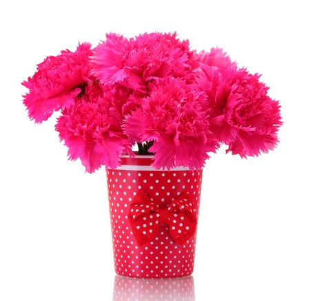 Bouquet of carnations in a vase isolated on white photo