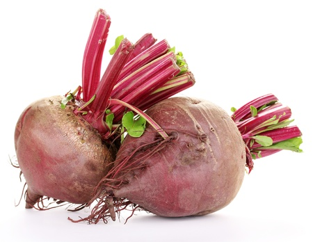 Young red beets isolated on white photo