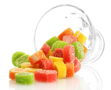 colorful jelly candies in glass bowl isolated on white  photo